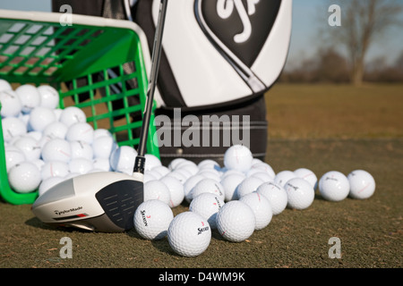 Golf range balls and driver on a golf practice ground England UK United Kingdom GB Great Britain - Stock Photo