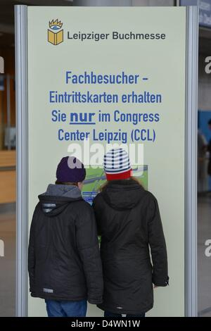 Visitors at the Leipzig book fair in 2013. - Stock Photo
