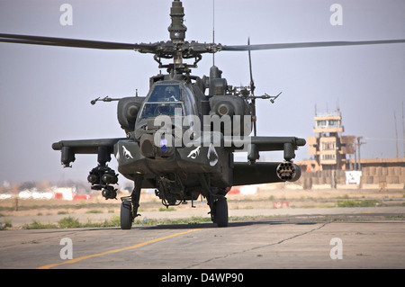 An AH-64 Apache helicopter returns from a mission over Northern Iraq during Operation Iraqi Freedom. - Stock Photo
