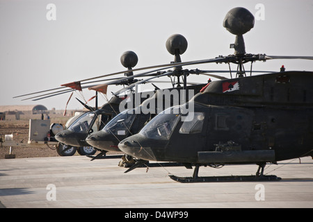 OH-58D Kiowa helicopters on the flight line at COB Speicher, Tikrit, Iraq, during Operation Iraqi Freedom. - Stock Photo