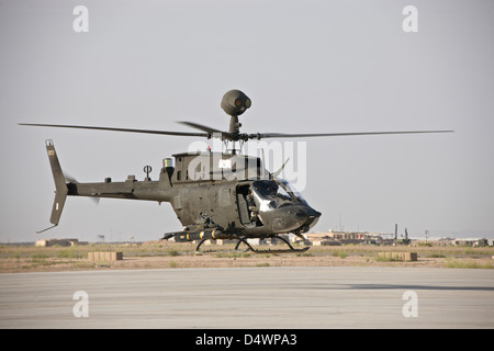 An OH-58D Kiowa helicopter takes off from COB Speicher, Tikrit, Iraq, during Operation Iraqi Freedom. - Stock Photo