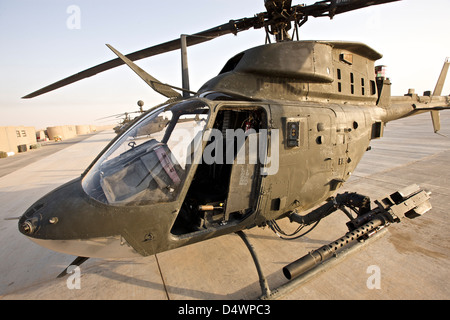 An OH-58D Kiowa helicopter sits on the tarmac at COB Speicher, Tikrit, Iraq, during Operation Iraqi Freedom - Stock Photo