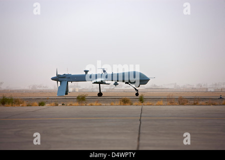 A MQ-1 Predator unmanned aerial vehicle taxiing at COB Speicher, Tikrit, Iraq, during Operation Iraqi Freedom. - Stock Photo
