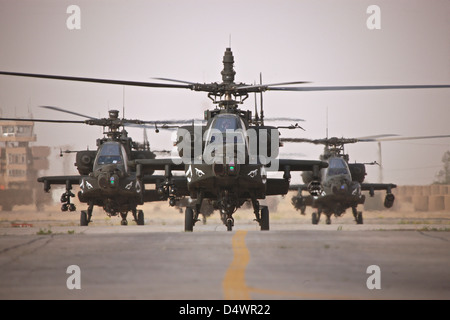 A group of AH-64D Apache helicopters on the runway at COB Speicher. - Stock Photo