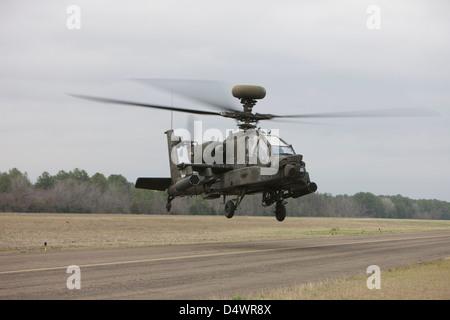 An AH-64 Apache helicopter in midair, Conroe, Texas. - Stock Photo
