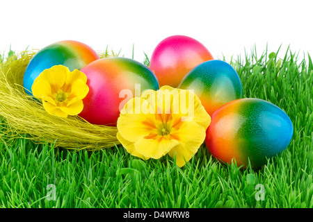 Easter colored eggs on the green grass - Stock Photo