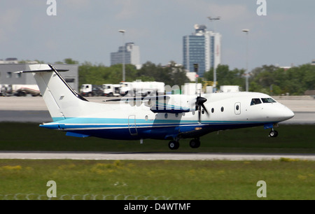 U.S. Air Force Dornier 328 airplane of the 27th Special Operations Group, taking off from Stuttgart Airport, Germany. - Stock Photo