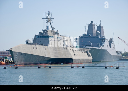 The USS Independence (LCS-2), foreground, and USS Mesa Verde (LPD 19) docked together at Naval Station Norfolk, - Stock Photo