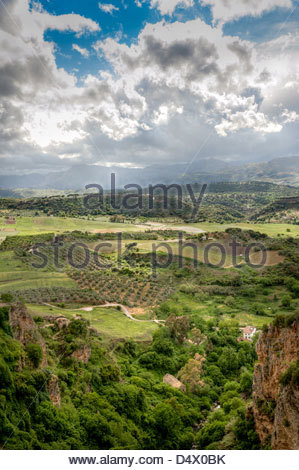 View of the El Tajo canyon and valley from the New Bridge in Ronda. - Stock Photo