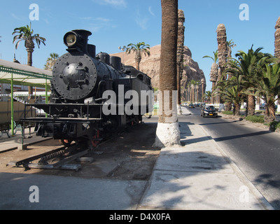 One of the original locomotives of the Arica to La Paz railway on display in the town centre of Arica - Stock Photo