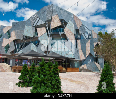 Federation Square, Melbourne, Australia. Christmas trees decorate this famous square ready for the holiday celebrations. - Stock Photo