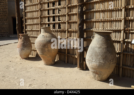 Clay pots on display at Dubai Museum, Dubai, United Arab Emirates - Stock Photo