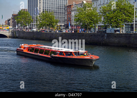 Spirit of Docklands tour boat on River Liffey in Dublin - Stock Photo