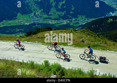 Family on a bike tour above the Val de Bagnes near Verbier, Valais, Switzerland - Stock Photo