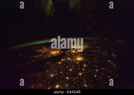 Northern lights over Europe at night from International Space Station - Stock Photo