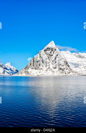 A view of mount Olstind on the Lofoten islands on a glorious sunny winter morning - Stock Photo