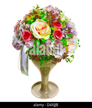 arrangement of flowers roses, hydrangea, herbs, berries and ribbons in a glass vase - Stock Photo