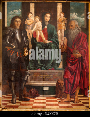 VERONA - JANUARY 27: Paint of Madonna, st. George and Jerome by Francesco Bonsignori from year 1488 in San Bernardino - Stock Photo
