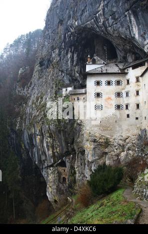 Exterior of Predjama Castle rock mountain hillside Slovenia - Stock Photo