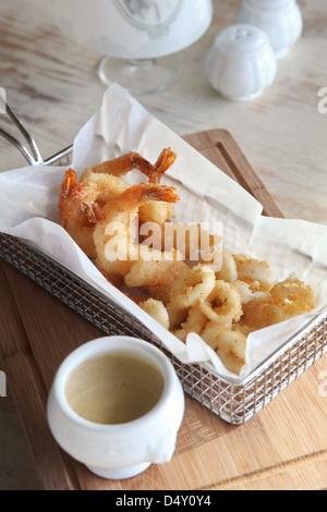 deep fried shrimps tempura served with a dip - Stock Photo