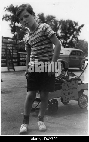 A Member of the Washington, D. C. Boys Club Wheels in a Load of Old Sneakers and Arctics to Add to the Nation's - Stock Photo
