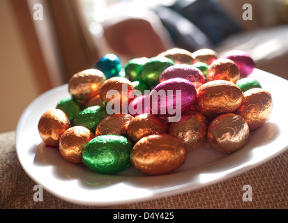 colourful easter eggs on plate - Stock Photo