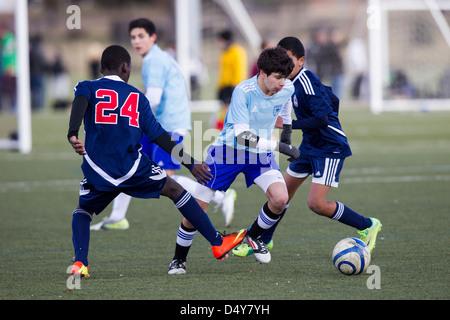 Teen boys soccer action. - Stock Photo