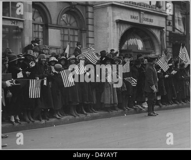 Crowds waiting for the parade of the famous 369th [African American] Infantry, formerly 15th New York regulars, - Stock Photo