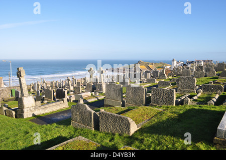 Graves at Barnoon Cemetery St. Ives Cornwall, England with sea and blue sky - Stock Photo