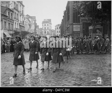 Members of the 6888th Central Postal Directory Battalion take part in a parade ceremony in honor of Joan d'Arc... - Stock Photo