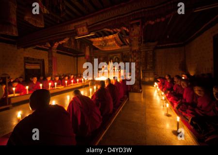 Bhutan, monks in temple. - Stock Photo