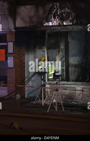 Tamworth, Staffordshire, UK. 20th March 2013. Fire rips through nightclub. Firefighter enters the building with - Stock Photo