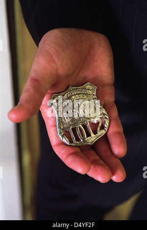 Monday, Oct. 15, 2001, President George W. Bush holds the badge of a police officer killed in the September 11th - Stock Photo