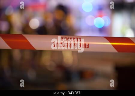 Tamworth, Staffordshire, UK. 20th March 2013. Fire rips through nightclub. Hazard tape at the scene of a fire. Credit: - Stock Photo