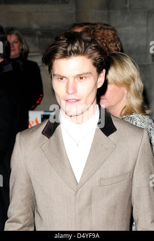 London, UK. 20th March 2013. Guest attends the Private View of 'David Bowie is influencing your behaviour'  . The - Stock Photo