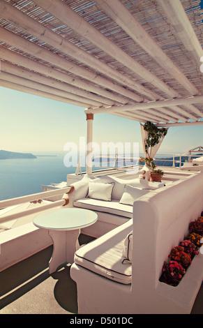 Breathtaking view of the caldera from a balcony on Santorini island, Greece. - Stock Photo