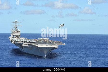 US Navy Nimitz-class aircraft carrier USS Abraham Lincoln transits the Pacific Ocean March 15, 2011. - Stock Photo
