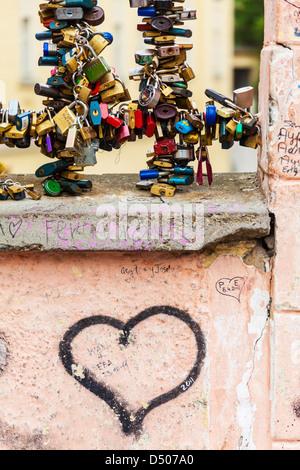 Padlocks as symbols of eternal love on the bridge over Certovka Canal in Malá Strana, Lesser Town, Old Prague, Czech - Stock Photo