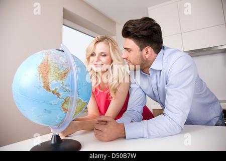 Couple making holiday plans - Stock Photo
