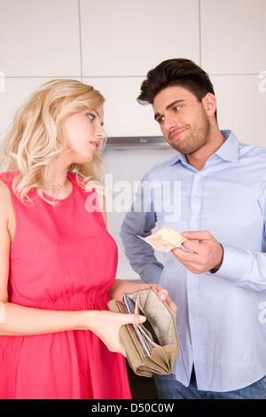 Woman borrowing money - Stock Photo