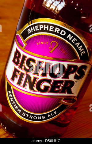 Close up view of Bishops Finger brand beer label on a bottle of real ale made by Kentish brewer Shepherd Neame for - Stock Photo