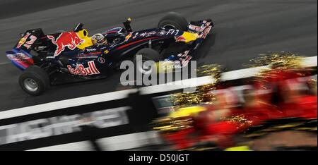 German Formula One World Champion Sebastian Vettel drives his car during the race of Champions at Esprit Arena in - Stock Photo