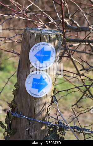 A bridleway sign on a post along Hollowshot Lane (Track) near Kingsclere in Hampshire - Stock Photo