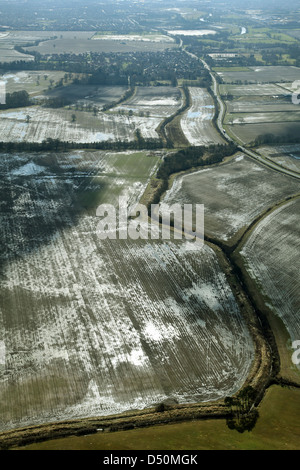 aerial view of wet and sodden agricultural fields, looking into sun it shows wet they are - Stock Photo