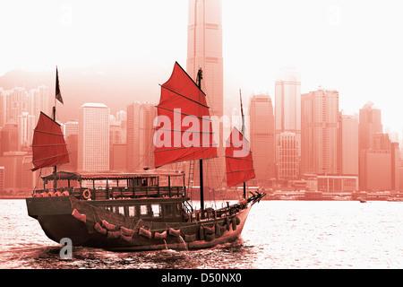 Sailing in Victoria Harbor in Hong Kong. - Stock Photo
