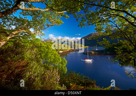A yacht moored in the calm waters of Bishop's Bay on Loch Leven, near Ballachulish, Argyll and Bute region, Scotland, - Stock Photo