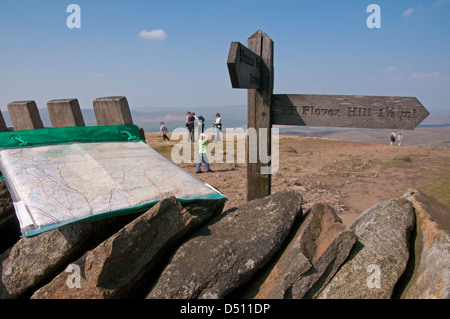Wooden fingerpost or waymark post & walker's map, on scenic sunny Pen-y-ghent summit (one of Yorkshire Three Peaks) - Stock Photo