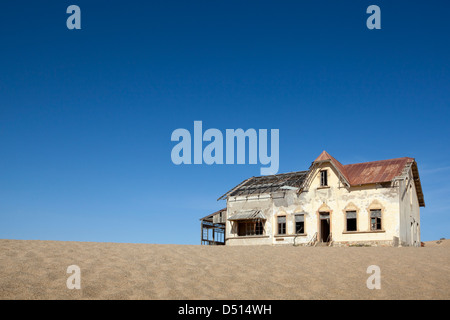 The ruined house of the former accountant in the deserted diamond mining town of Kolmanskop, Namibia - Stock Photo