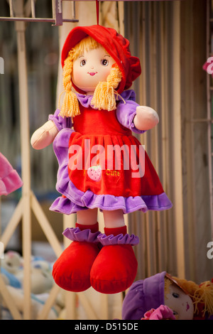 rag doll, fabric doll hanging on a string - Stock Photo
