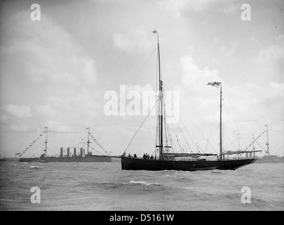 HMS 'Euryalus' and unnamed Ketch of the Royal Yacht Squadron in Stokes Bay - Stock Photo